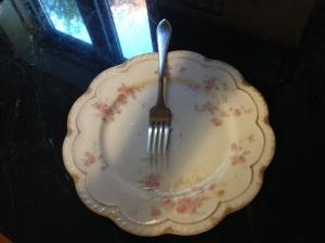 An emptied plate beside a full heart