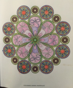 Blended cats clash with a mandala frame from Coloring Mandalas by Wendy Piersall