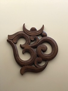 Om carved in wood